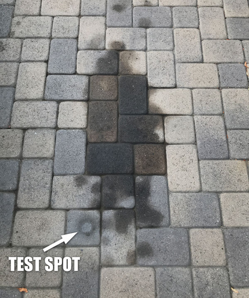 large oil stain in a reviewer's stone driveway, with one part labeled