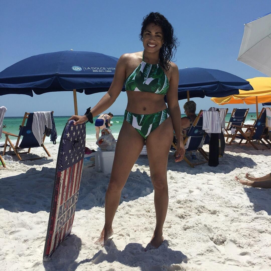 A reviewer in the white bikini with green leaf print