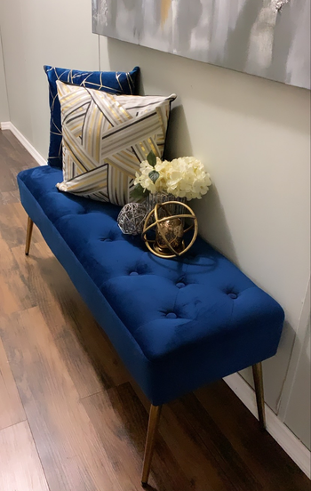 blue tufted bench in an entryway