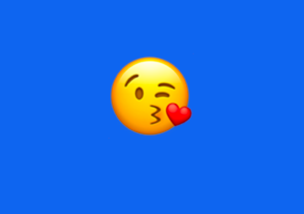 An emoji winking and blowing a kiss