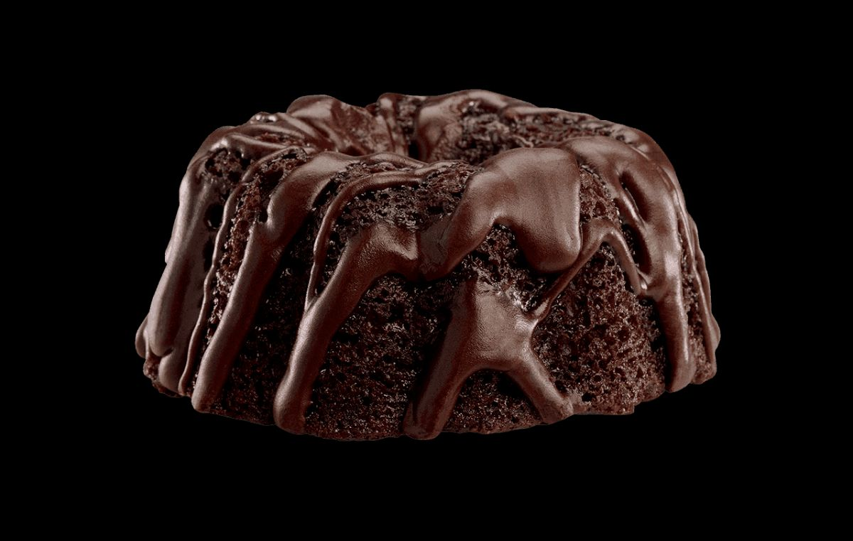 A mini chocolate bundt cake with chocolate frosting