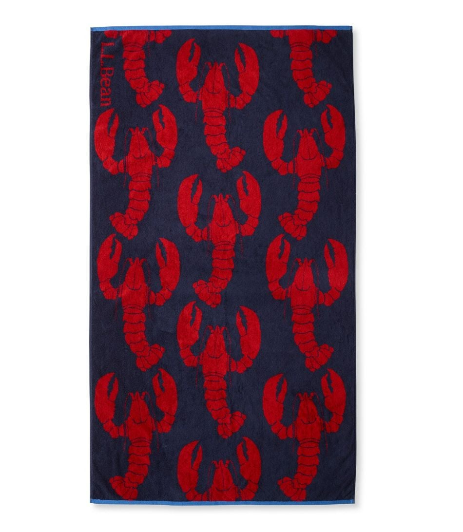 A beach towel with a lobster pattern on it
