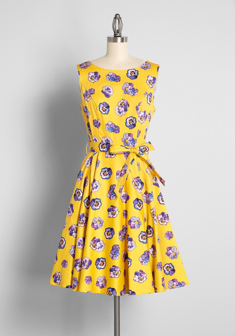 bright yellow sleeveless dress with purple flowers