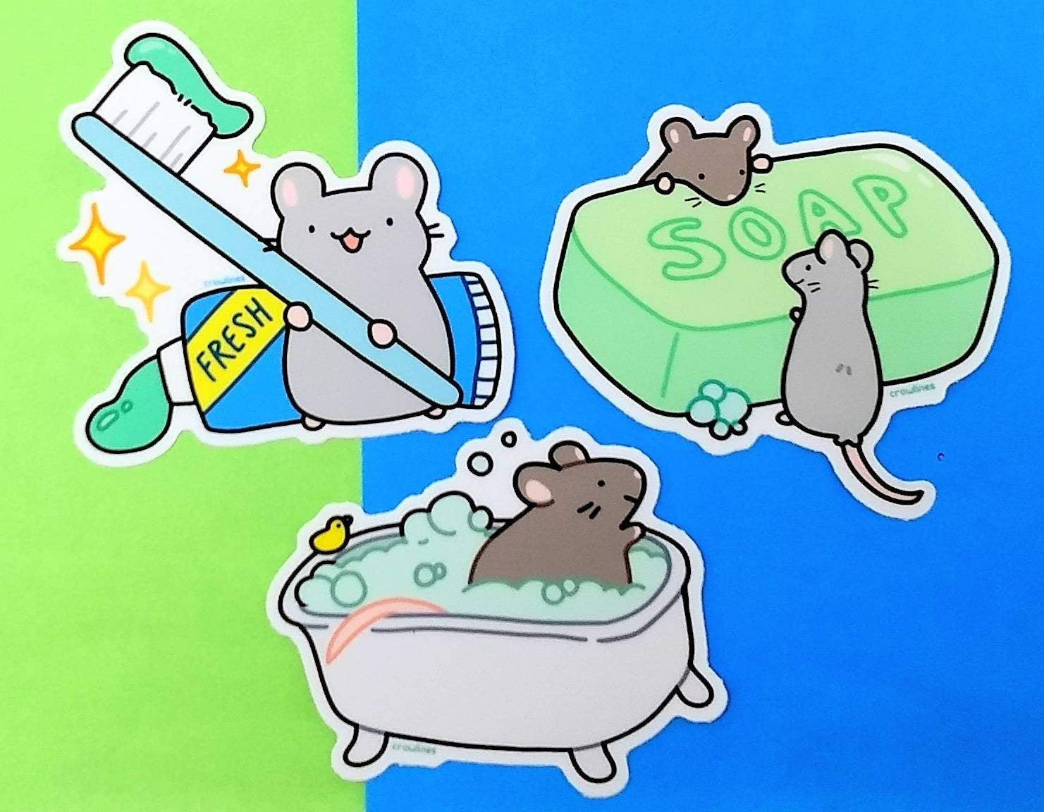stickers of mice in a bathtub, with soap, and with toothpaste