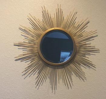 a reviewer photo of the mirror hung on the wall