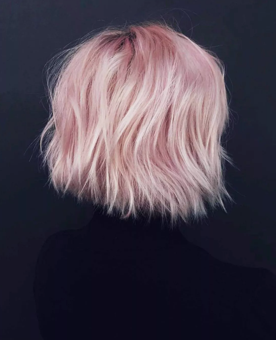 a model with short pink hair