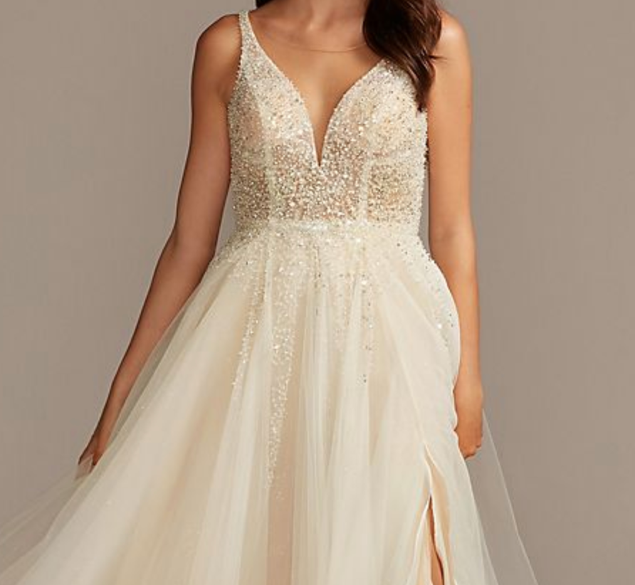 A wedding dress with a beaded bodice and a flowy, tulle skirt