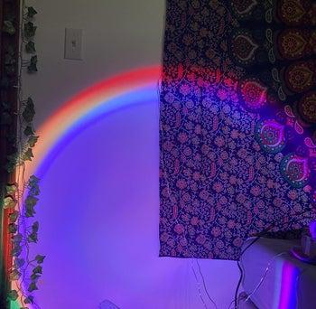 the rainbow circle light on a wall