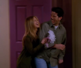 Ross and Rachel are walking out the door, laughing and linked together