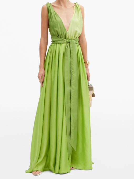 A long silk gown with a plunging neckline and a tie around the waist