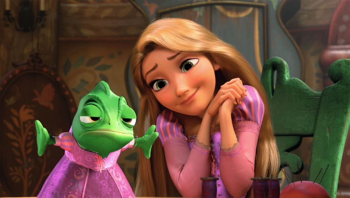 "Rapunzel looks adoringly at Pascal, who she has placed a bright dress on, in ""Tangled"""