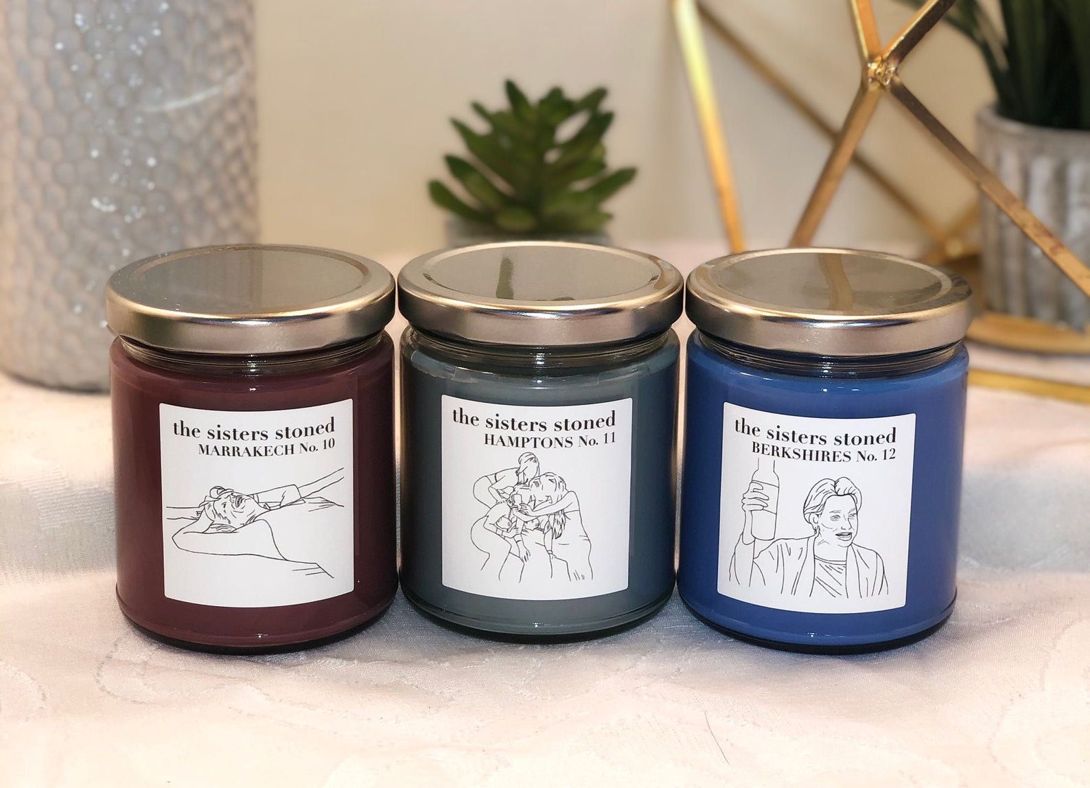 three different real housewives of new york themed candles