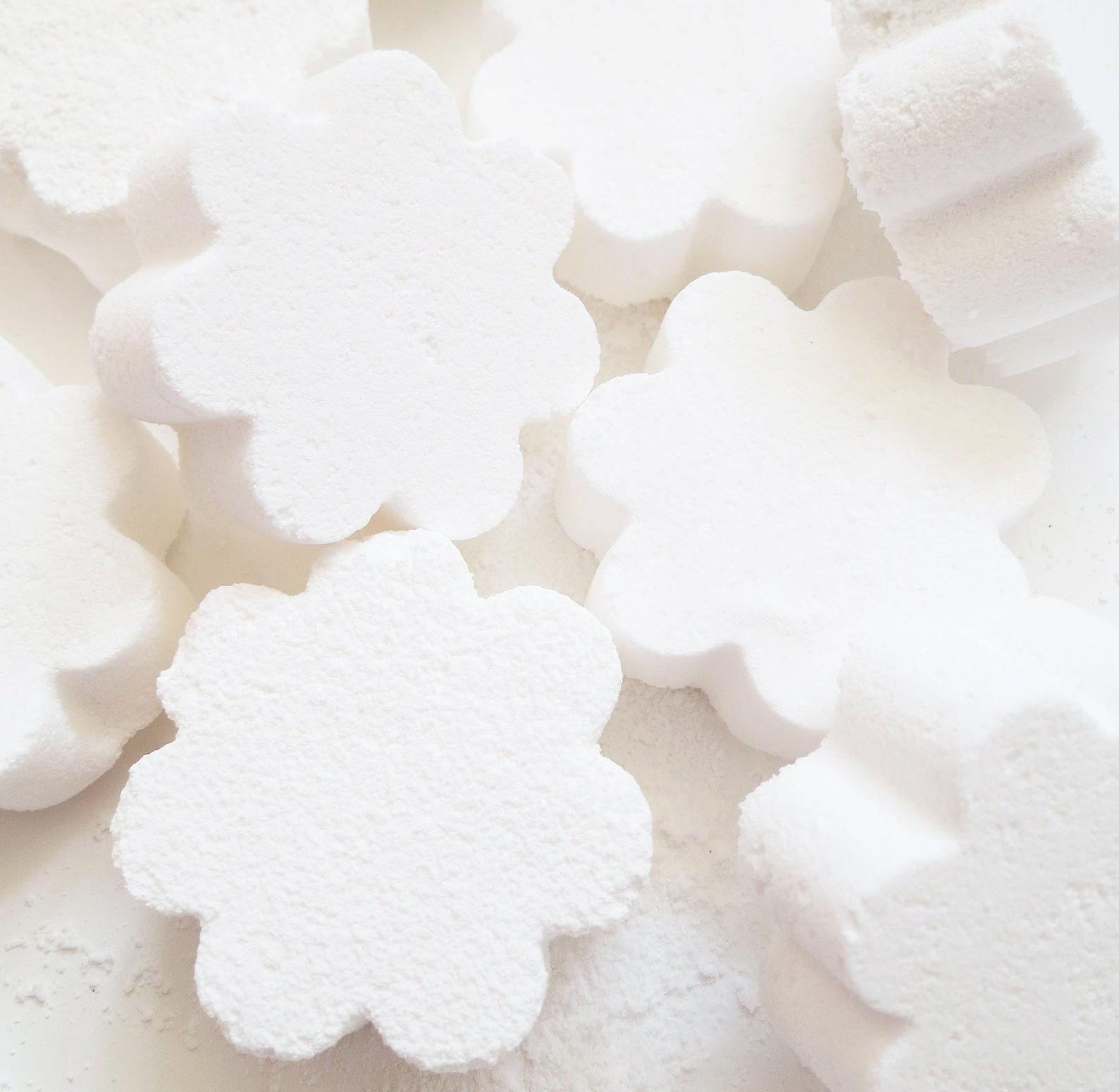 White flower-shaped toilet bombs