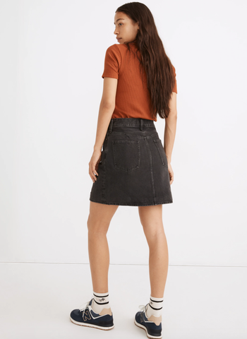 the same model showing the back of the skirt