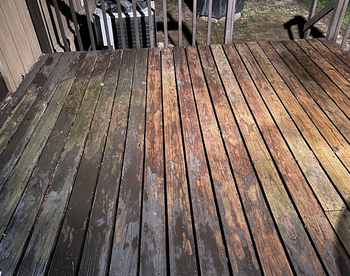 reviewer image of a deck being washed with half of it looking gray and dull, and the other half cleaned