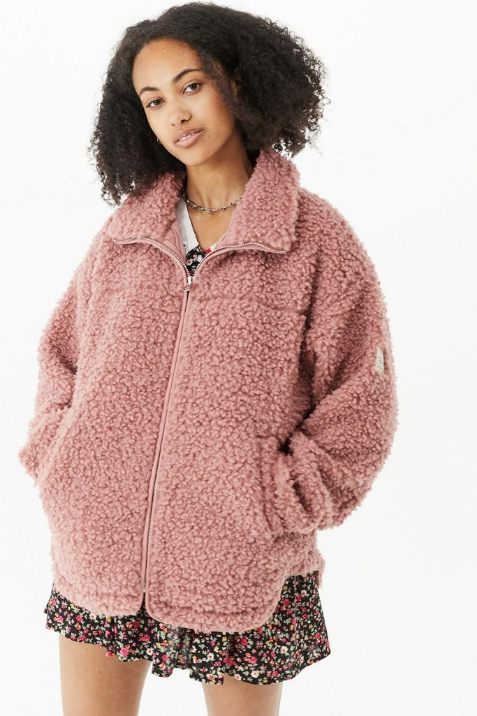 a fuzzy pink zip up jacket