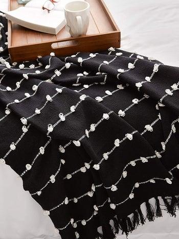 the black throw blanket