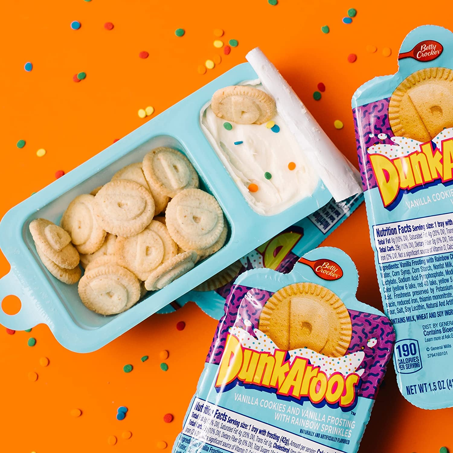 A snack pack with one section for small round cookies and another for frosting