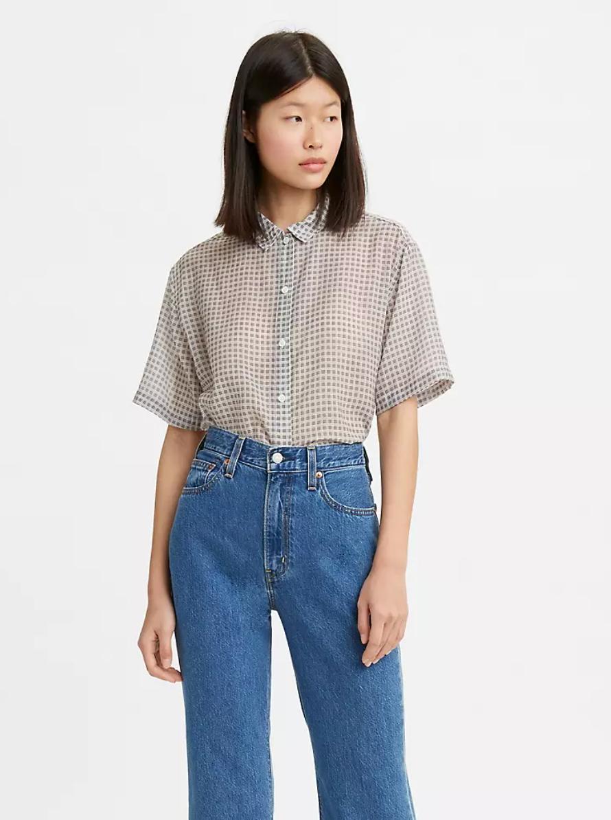 model wearing the grey button down shirt