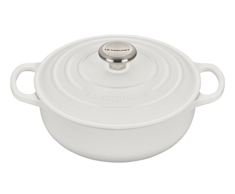 the pan in white with handles on each side and lid