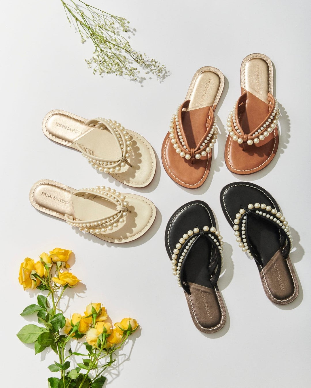 the pearl-encrusted flip flops in white, black, and brown