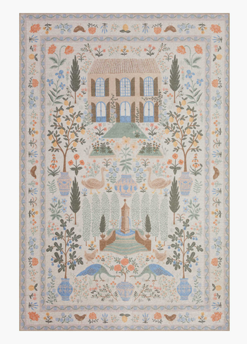 zoomed out view of the floral cream rug
