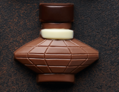 A small chocolate bottle of perfume