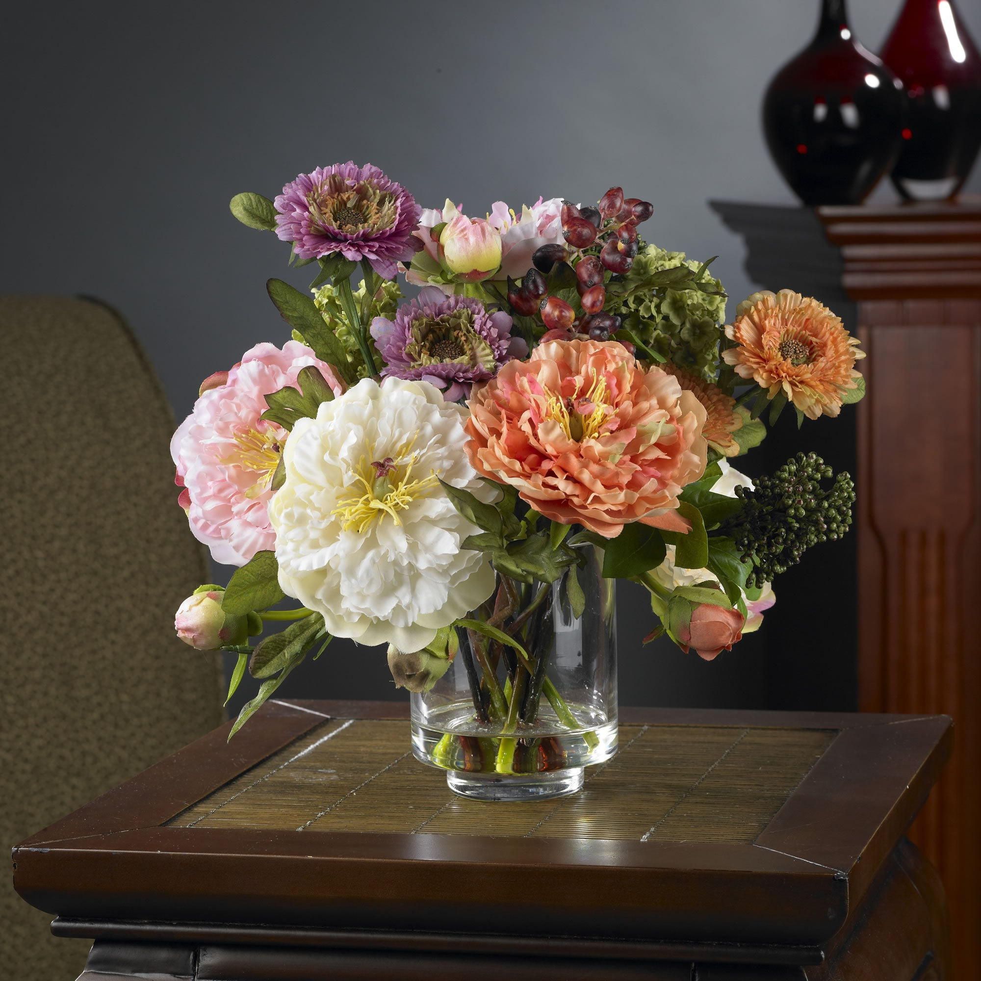 a glass vase of brightly colored peonies