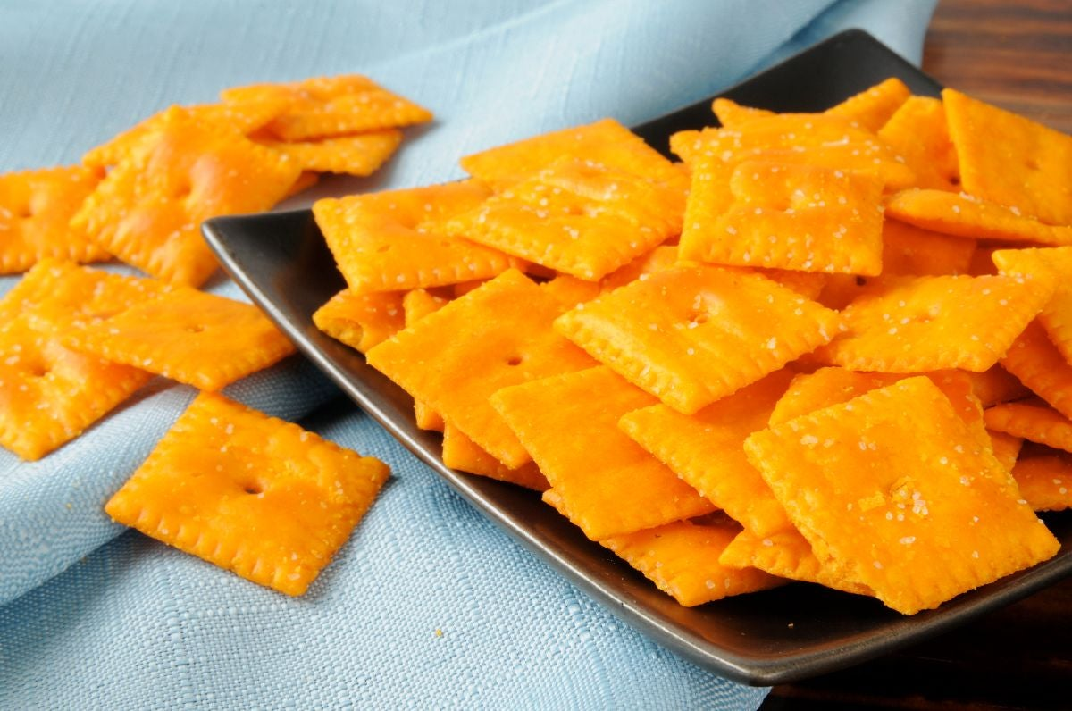Square cheese crackers on a plate