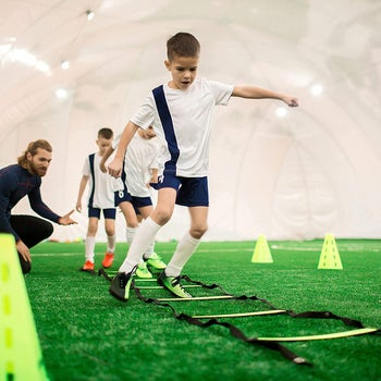 kid using latter for agility sprints on grass
