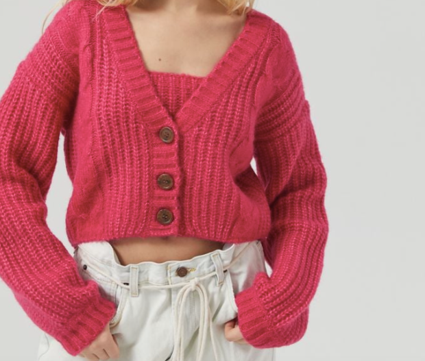 a hot pink knit cardigan with buttons up the front
