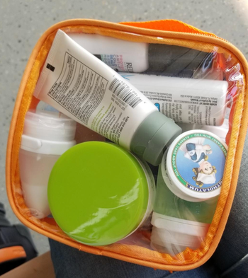 reviewers orange bag with products inside