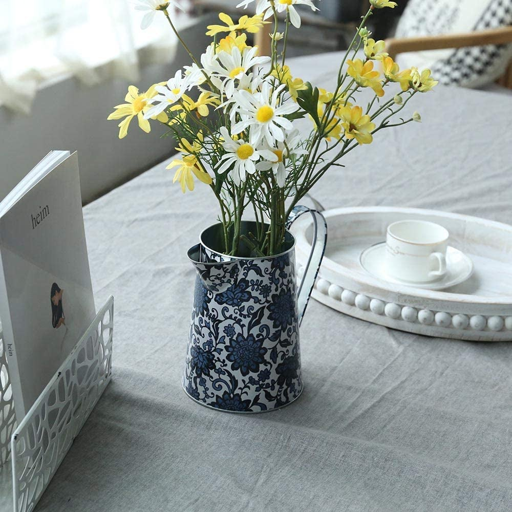 the blue rustic pitcher holding a bouquet of flowers