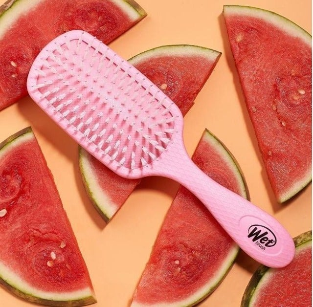 a pink wet brush on top of watermelons