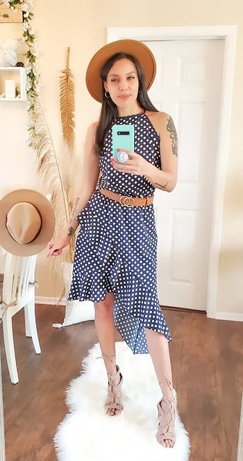 reviewer wearing the blue with white polka dots version