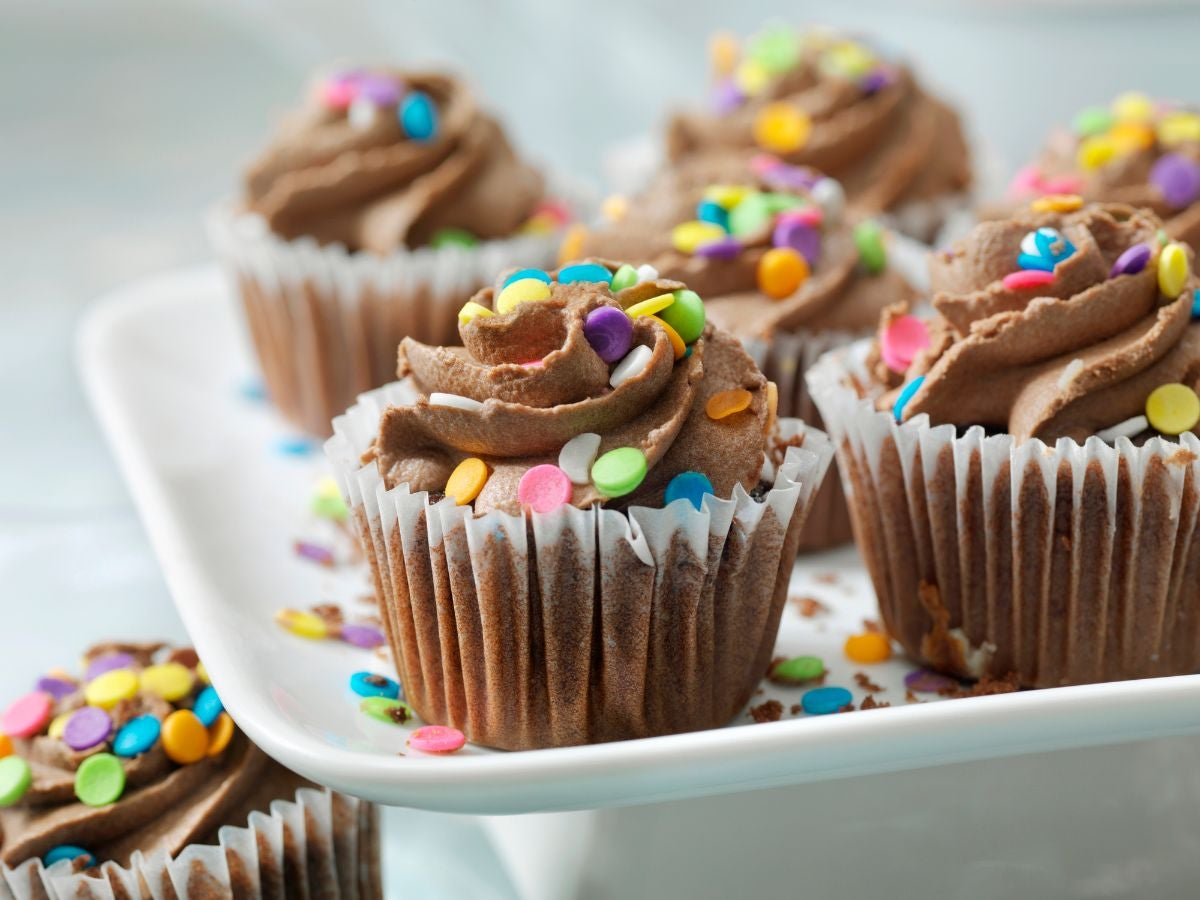 Chocolate cupcakes with chocolate frosting and sprinkles