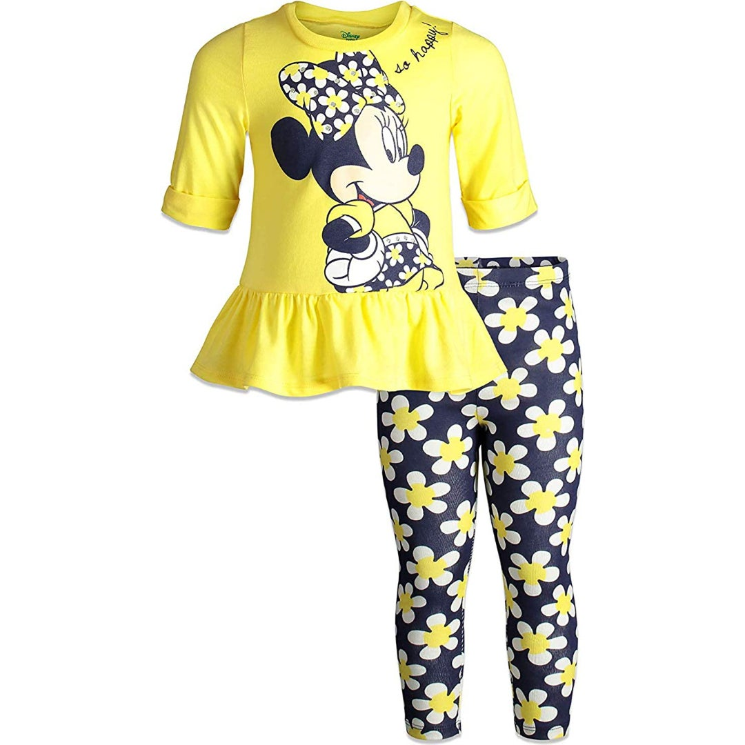 a yellow top with minnie mouse on it and blue leggings with daisies on them