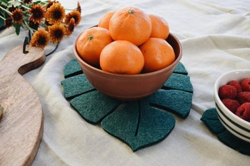 bowl of fruit on large trivet