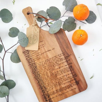the wood board engraved with small script of a full recipe