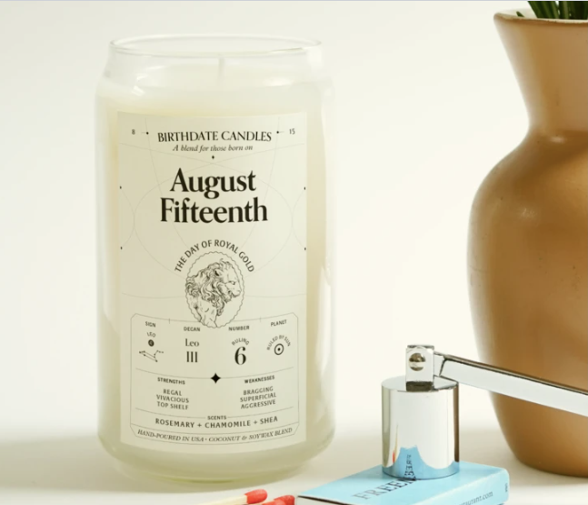 the August 15th candle in tall clear jar