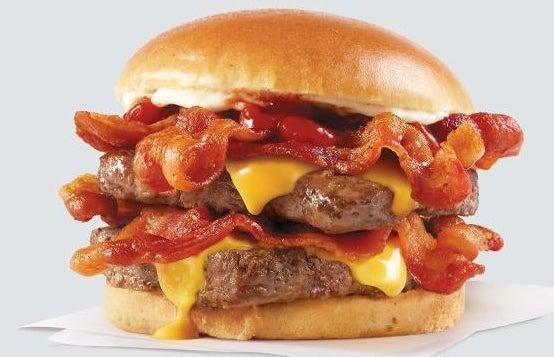 A double cheeseburger with bacon, ketchup, and mayo