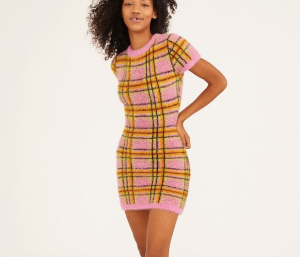 a fuzzy, yellow, orange, black, and pink plaid dress with a high neckline and short sleeves