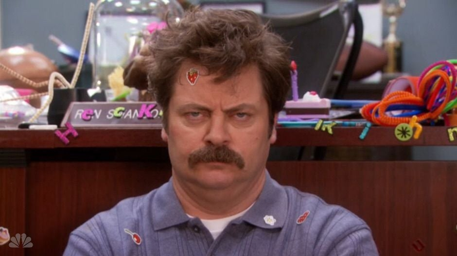Ron looks unimpressed as he's covered in stickers