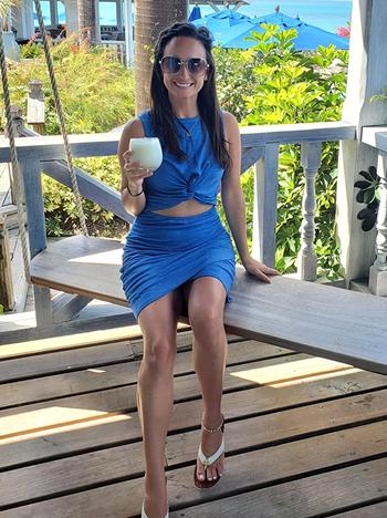 reviewer wearing blue dress