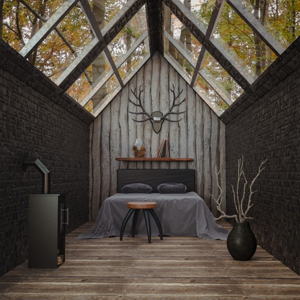 A smaller, cabin-inspired room with a skylight over head, a piece of deer decor above the bed, a stool in front of the bed, and a large pot full of tree branches to the left of the bed