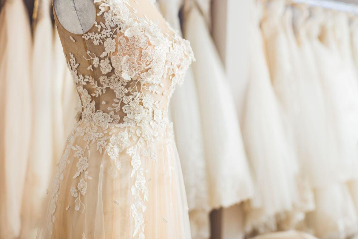 Sleeveless, floral applique wedding dress
