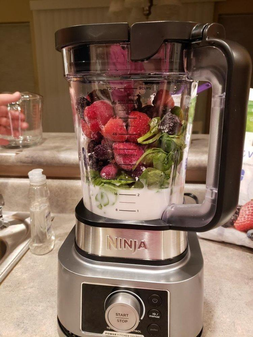a review photo of fruits veggies and milk in the blender before blending