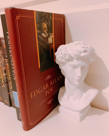 a reviewer's david bust being used as a bookend
