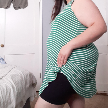 Reviewer showing shorts under a dress