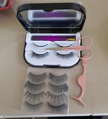 a reviewer photo of the lashes and application kit